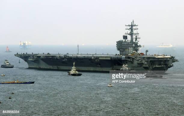 Nuclear-powered aircraft carrier USS Ronald Reagan departs the Yokosuka naval base in Yokosuka, Kanagawa prefecture on September 8, 2017. / AFP PHOTO...