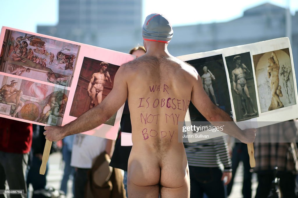 Nude activist Trey Allen holds up pictures of nude statues as he protests San Francisco's new ban on nudity at San Francisco City Hall on February 1, 2013 in San Francisco, California. At least four nude activists were arrested as they protested San Francisco's new ban on nudity in public places. The measure proposed by Supervisor Scott Wiener is being challenged by activists who call the ordinance unfair because it grants exceptions for nudity at permitted public events.