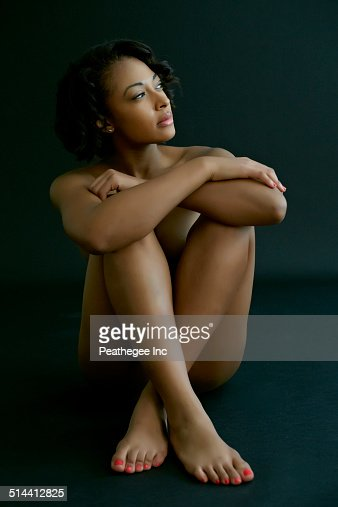 Nude African American Woman Hugging Her Knees Photo -3384