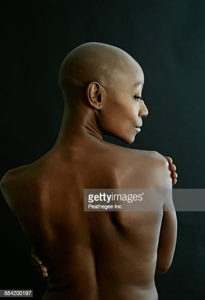 Nude African American woman looking over her shoulder