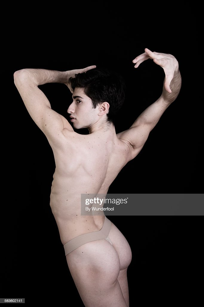 Nude backside of a male ballet dancer : Stock Photo