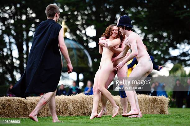 Nude Blacks players try to catch a streaker during their match against Romanian Vampires on September 24 at Larnach castle in Dunedin during the New...