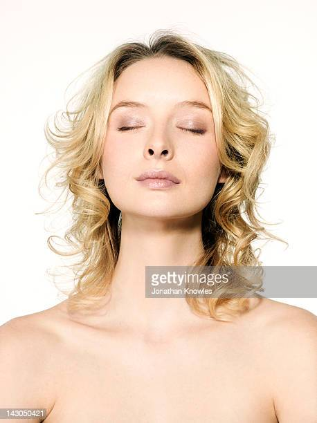 Nude blonde female with eyes closed