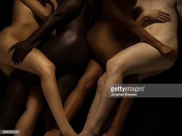 Nude bodies in different skin colours entwined