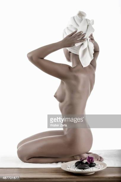 Nude Caucasian woman drying her hair in spa
