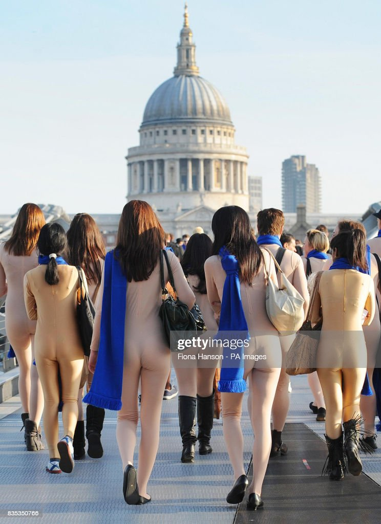 Nude commuters on Millennium Bridge, London this morning to launch the 308 Peugeot Coupe Cabriolet. The event is to highlight the 'naked' ambition behind the new car's advanced airwave neck heating system.