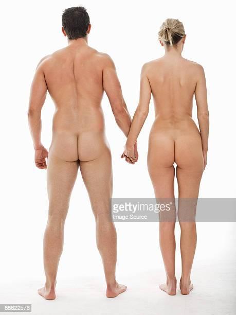 nude couple holding hands - mujer desnuda cuerpo entero fotografías e imágenes de stock