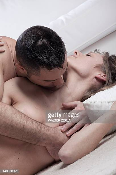 nude couple kissing on floor - kissing stock pictures, royalty-free photos & images