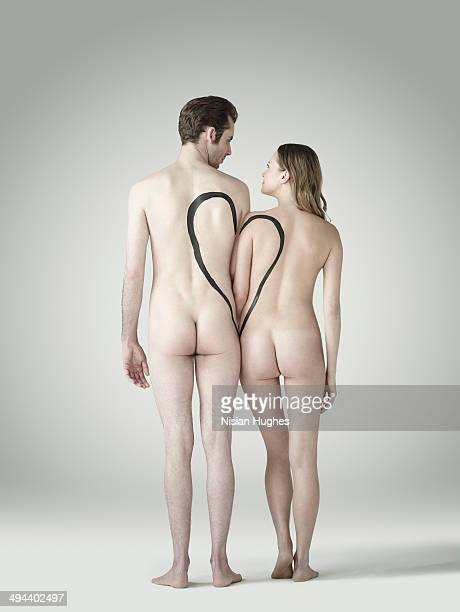 nude couple together with heart drawn on them