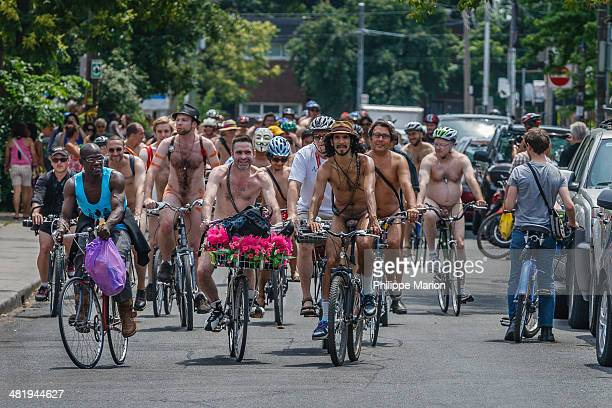 CONTENT] Nude cyclists participating in the World Naked Bike Ride in Kensington Market Toronto