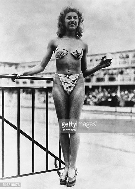 Nude dancer Micheline Bernardini models the first bikini at a contest to choose the most beautiful bathing girl The bikini is so small it can fit...