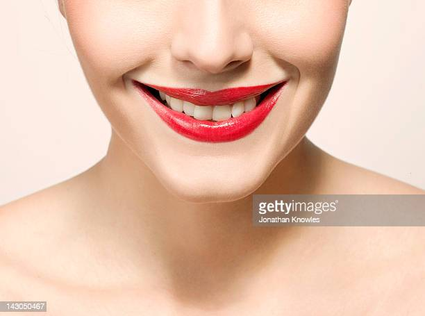 Nude female beauty, close up on lips smiling