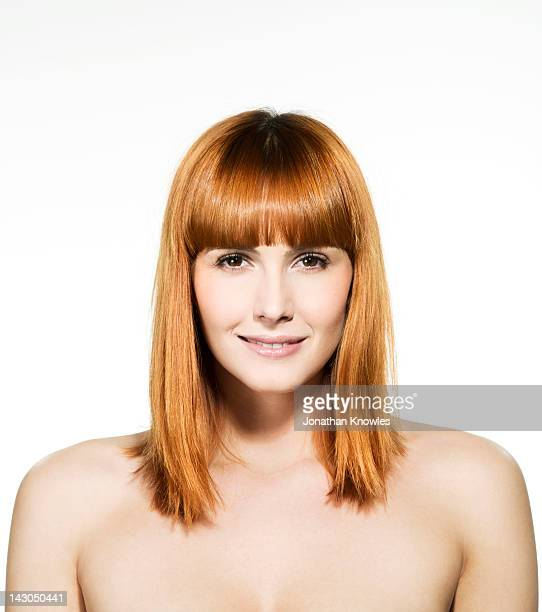 Nude female red hair beauty looking into camera