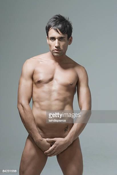 nude hispanic man covering his groin - underliv bildbanksfoton och bilder