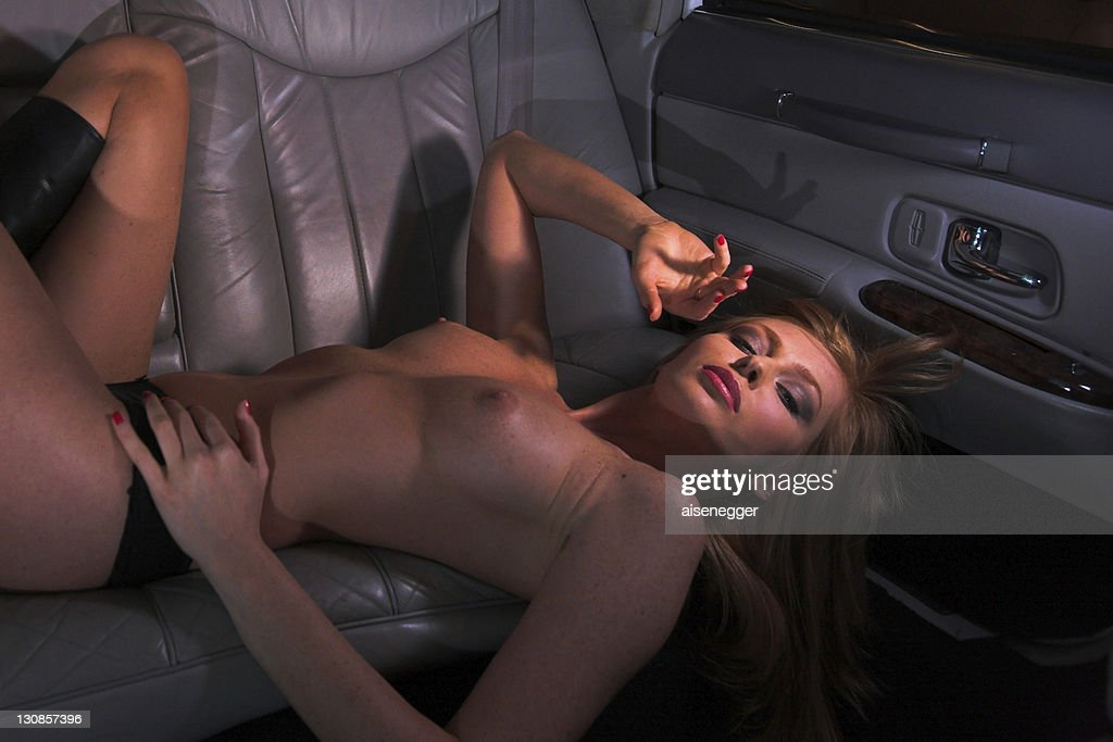Nude in the limousine, night drive in a stretched limousine : Stock Photo