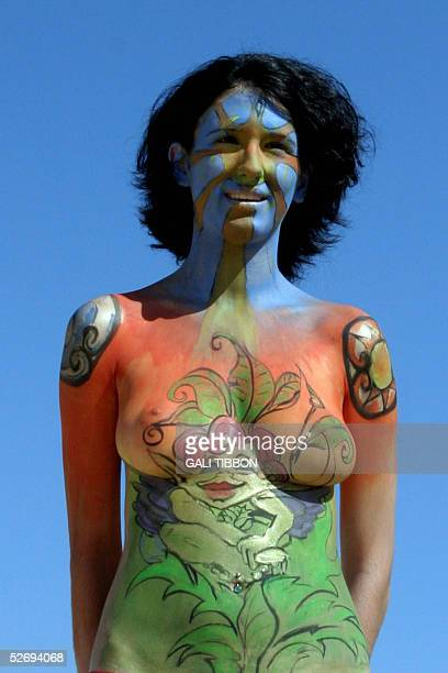 A nude Israeli girl displays her painted body 25 April 2005 during the Boombamela festival at Nitzanim beach in southern Israel The fourday festival...
