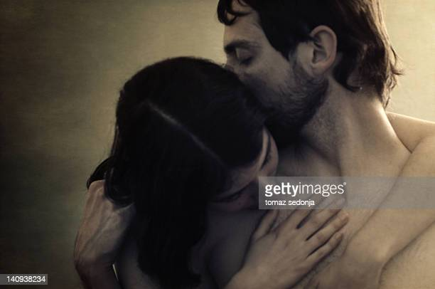 nude male and female embracing eachother - naturist couple stock pictures, royalty-free photos & images