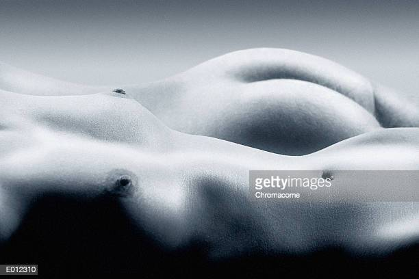 Nude male and female lying side-by-side in blue tone