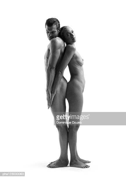 Nude man and nude woman back to back facing forward, B&W