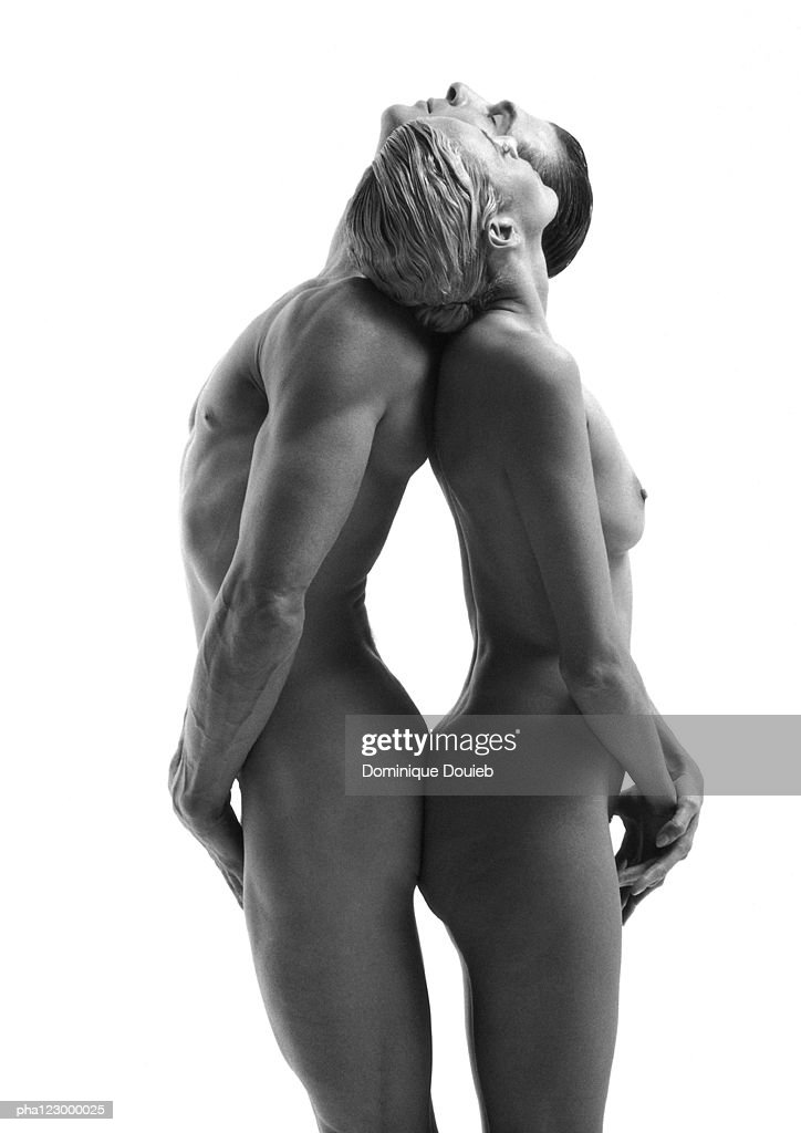 Nude man and nude woman, back-to-back, heads on partner's shoulders, B&W : Stockfoto