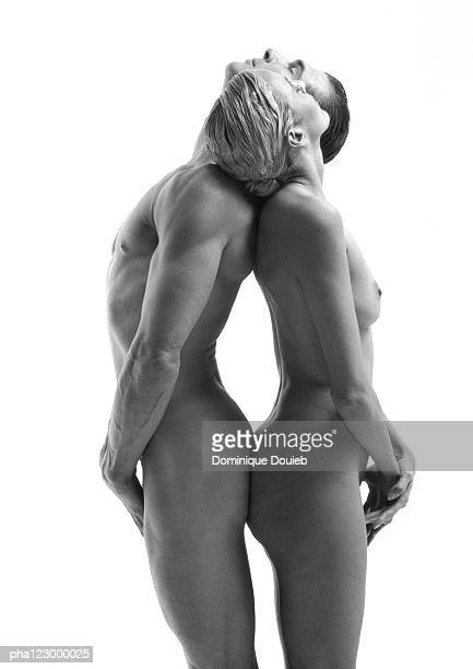 Nude man and nude woman, back-to-back, heads on partner's shoulders, B&W