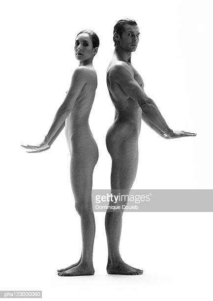 Nude man and nude woman, back-to-back, palms flat facing downward, B&W