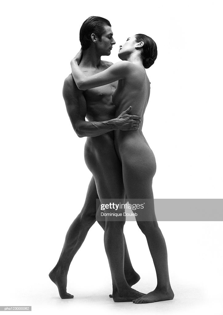 Nude man and nude woman embracing face to face, B&W : Stockfoto