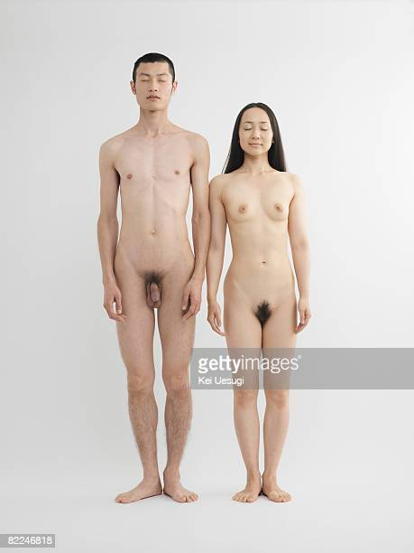 Nude man and woman standing together