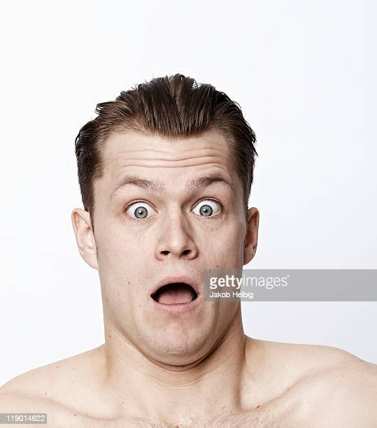Nude man making a funny face