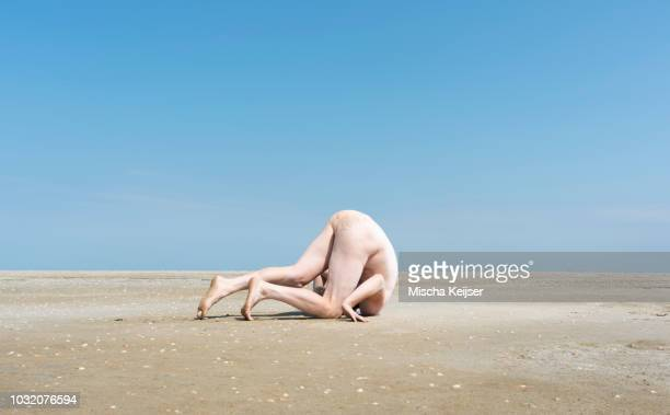 nude man on sandbank - naturist male stock pictures, royalty-free photos & images