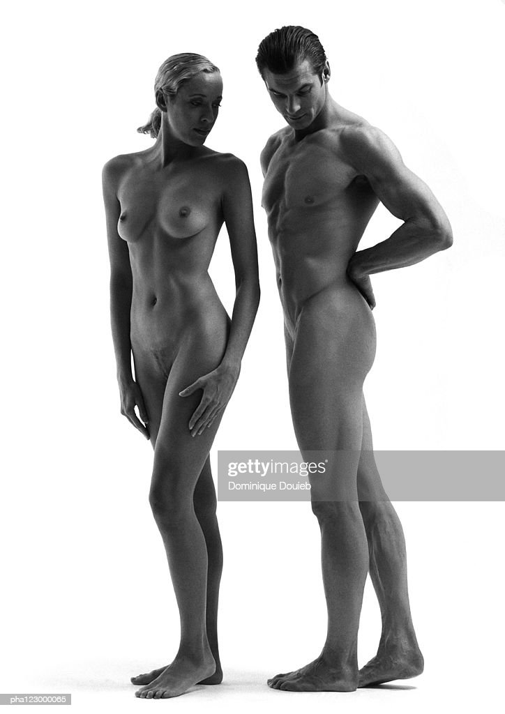 Nude man standing behind nude woman with straight posture, B&W : Stock Photo