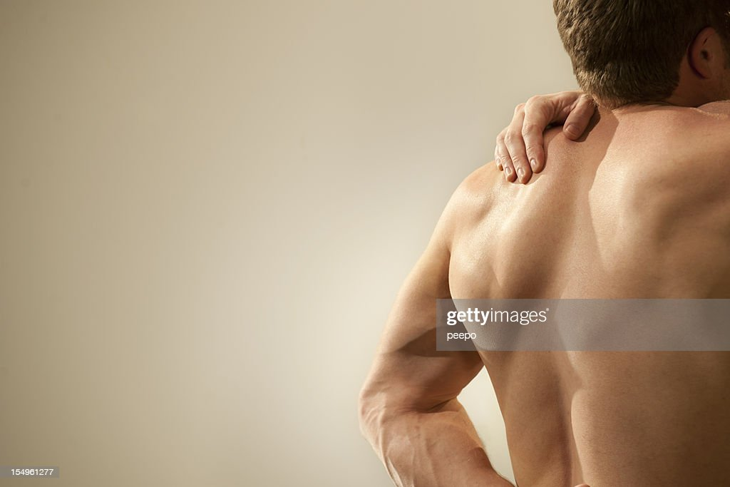 nude man with shoulder pain : Stock Photo