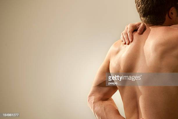nude man with shoulder pain