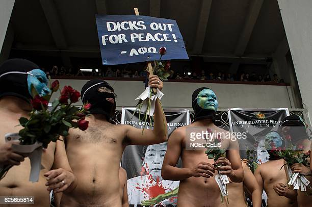 Nude members of a university fraternity participate in a Oblation Run to protest against the burial of the late dictator Ferdinand Marcos at the...