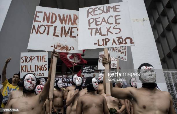 Nude members of a university fraternity participate in a Oblation Run to protest against the government's war on drugs campaign and the crackdown of...