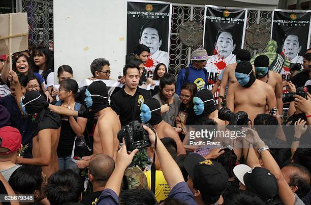 Nude members of the Alpha Phi Omega fraternity walk through the crowd during the annual Oblation Run at the University of the Philippines This year's...