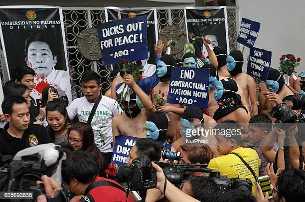 Nude members of the Alpha Phi Omega fraternity walk through the crowd during the annual Oblation Run at the University of the Philippines in Quezon...