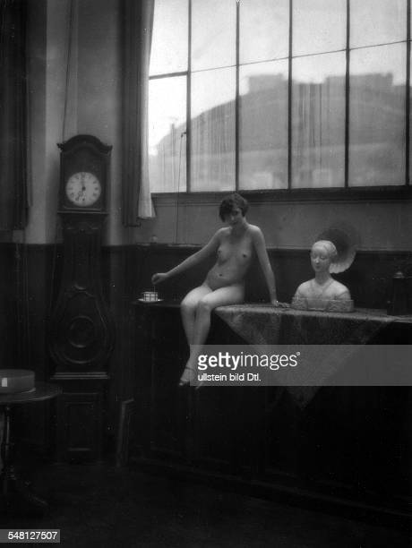 Nude model posing on a cabinet around 1928 Photographer James E Abbe Vintage property of ullstein bild