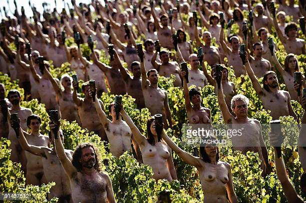 Nude models directed by US photographer Spencer Tunick pose in a Bourgogne wineyard near Macon centraleastern France on October 3 for a giant...