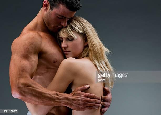 nude muscular man holding woman XXXL