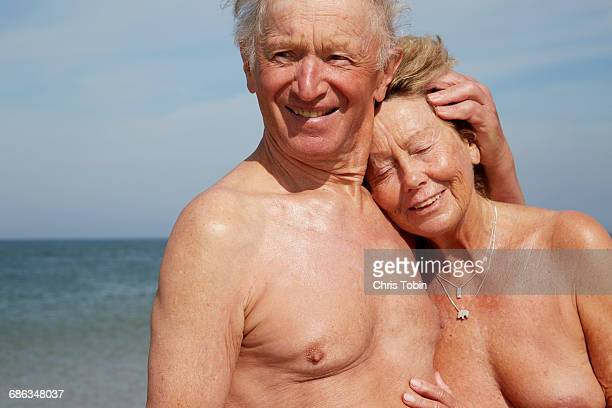 Nude old couple at beach