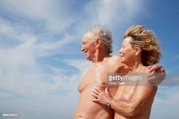 nude older couple portrait - naturism stock photos and pictures