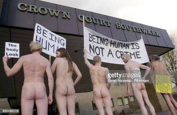 Nude protestors stand outside Southwark Crown Court in London in support of veteran nudist campaigner Vincent Bethell who appeared naked in the court...