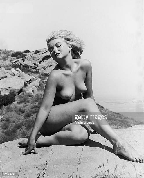A nude study of a young woman on a clifftop circa 1955