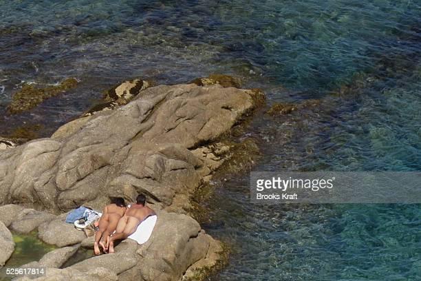 Nude sunbathers on a beach along the Mediterranean Sea near Saint Tropez France