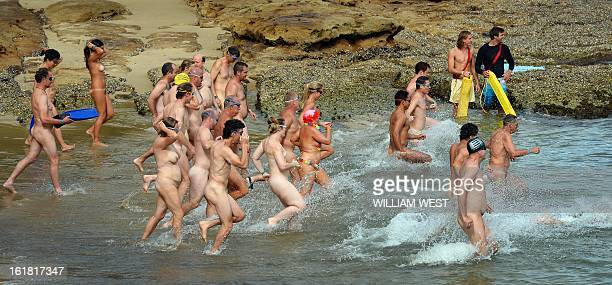 Nude swimmers hit the surf in the 'Sydney Skinny' in what is dubbed the first mass nude ocean swim in Sydney on February 17 2013 The inaugural Sydney...
