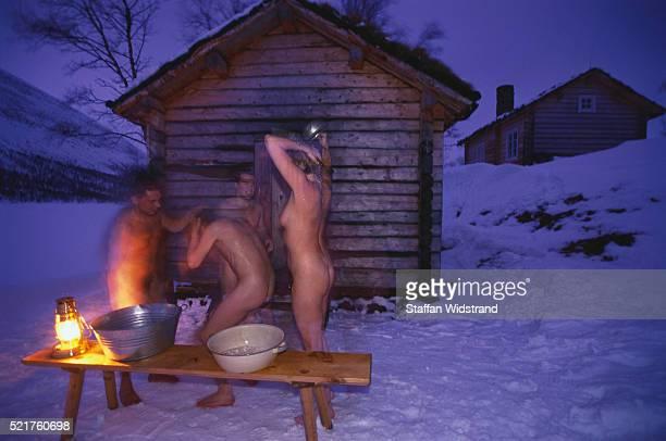 Nude Tourists Bathing Using Saami-Style Sauna