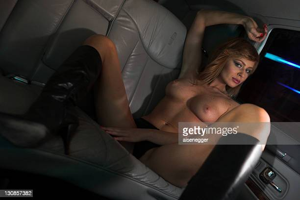 nude with boots, night drive in a stretched limousine - bare bottom women stock photos and pictures
