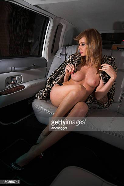 Nude with fur, night drive in a stretched limousine