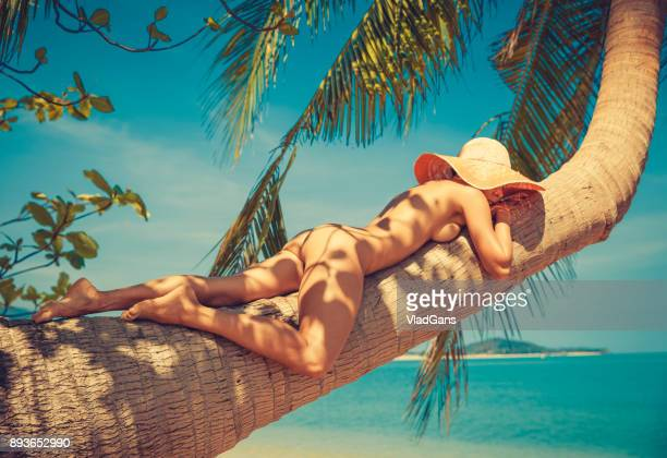 nude woman at tropical beach - naturism stock photos and pictures